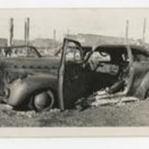 Badly damaged car with burned interior