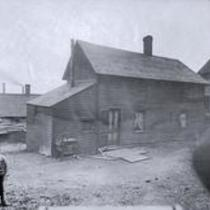 Unidentified house and child